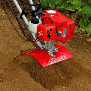 2-cycle tiller digging close-up