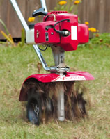 Lawn Aerator Attachment closeup in use