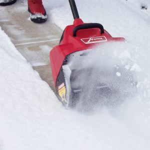 Mantis Electric Snow Shovel Clearing a Sidewalk