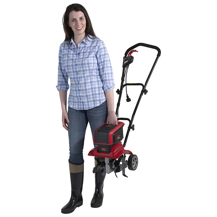 Woman holding Mantis Electric Tiller 3550