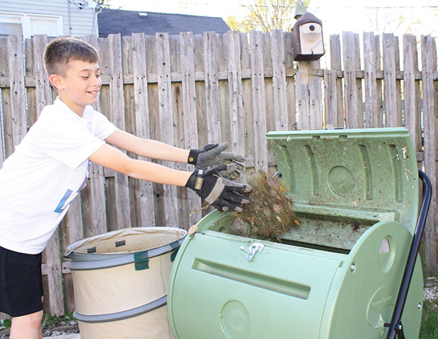 Child making Compost in the Backyard